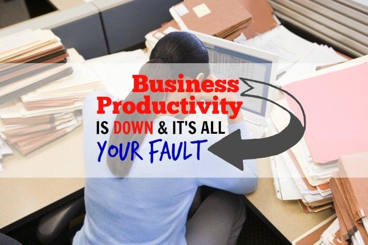 business-woman-overworked-clutter-desk-computer-pm